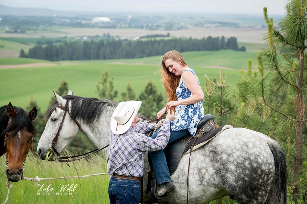 engagement proposal a couple with a white horse in the mountains in Moscow Idaho photographer luba wold