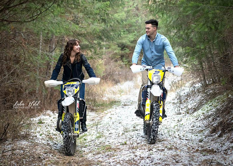engaged couple riding their dirt bikes in a snow photographer luba wold Post Falls Idaho engagement