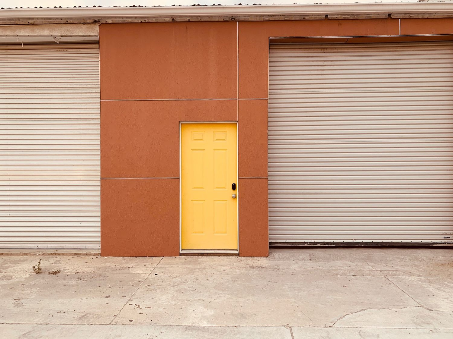 simply staging  8500 sqft yellow warehouse door