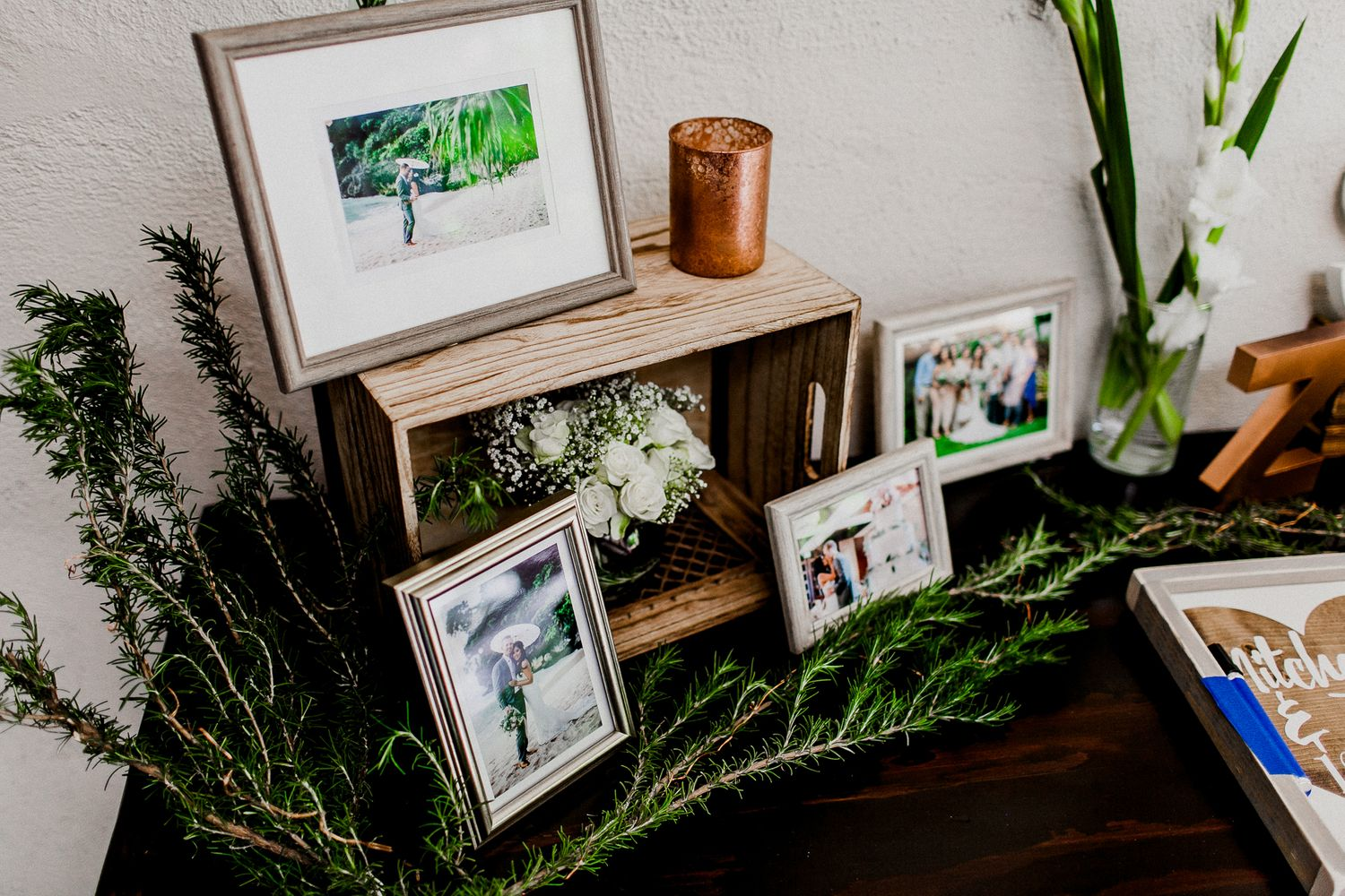 picture frames and floral design for welcome table