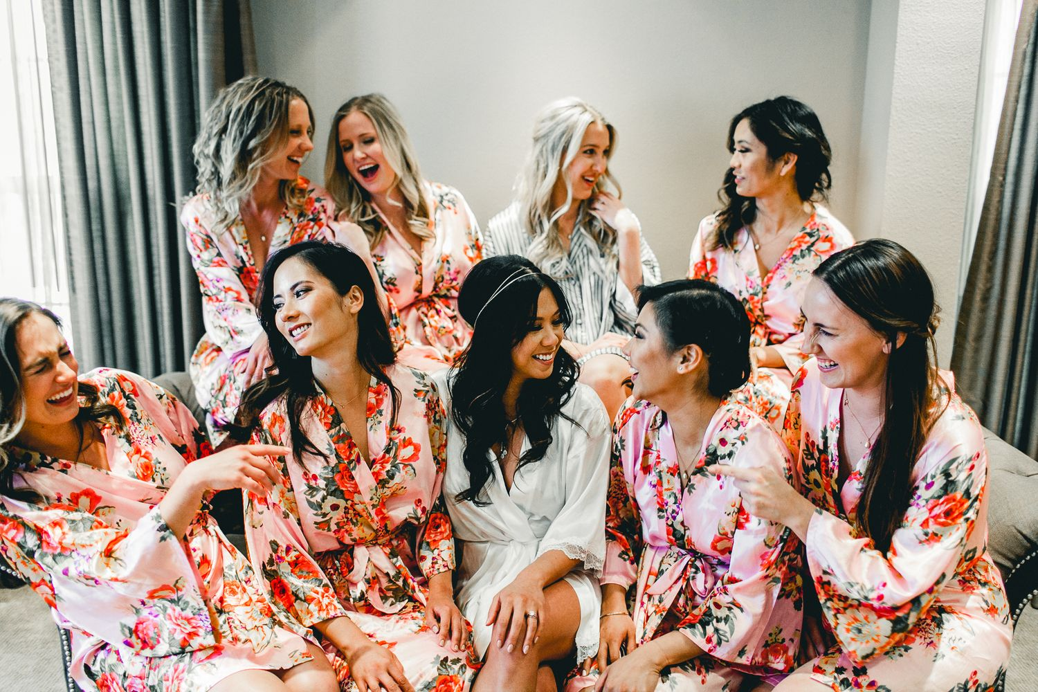 candid photo of bridal party and bride in robes