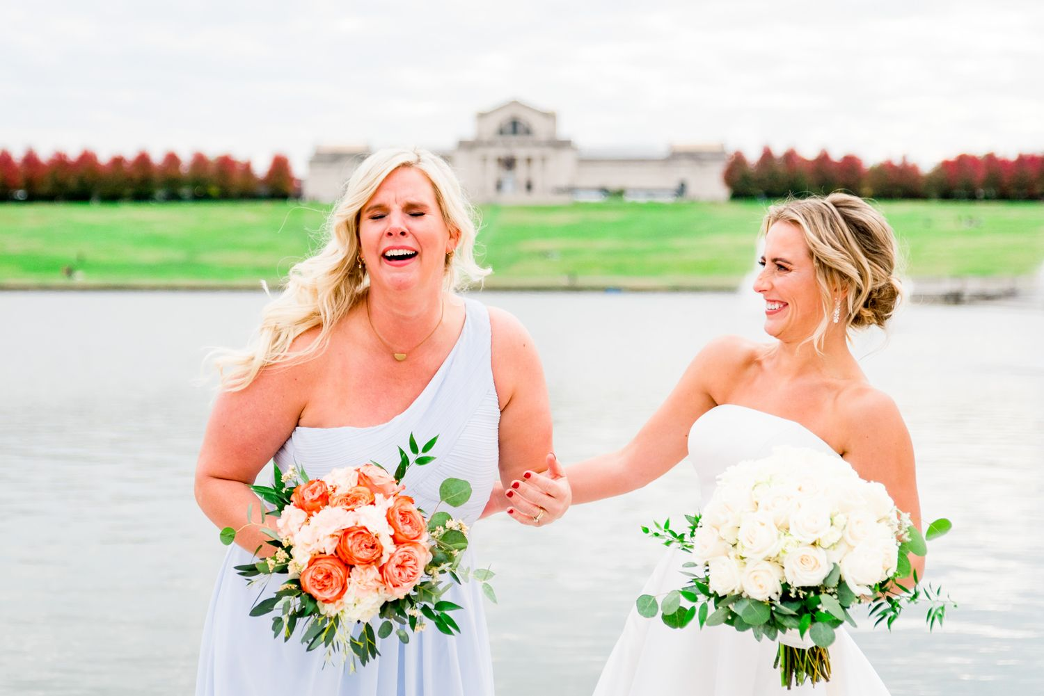 bride laughs and bridesmaid cries at fall wedding in Forest Park, STL