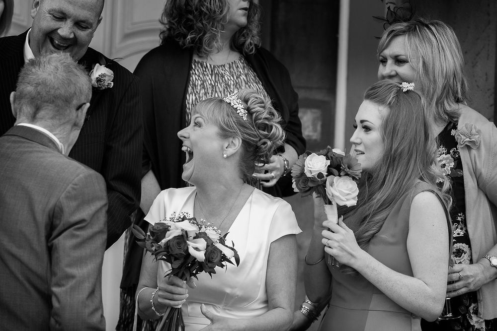 bride laughing really hard, black and white image at hothorpe hall