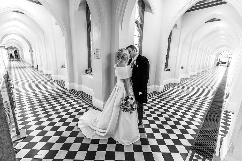bride and groom in a corridor intersection black and white at Stanbrook abbey