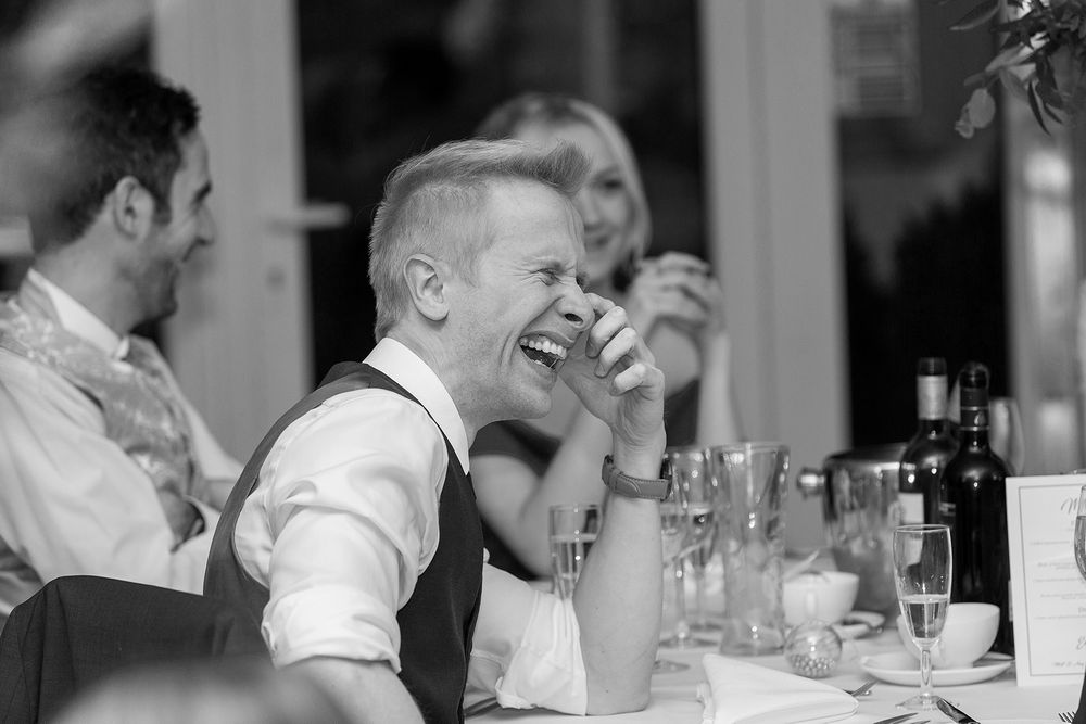 guest laughing during speeches at Stanbrook abbey