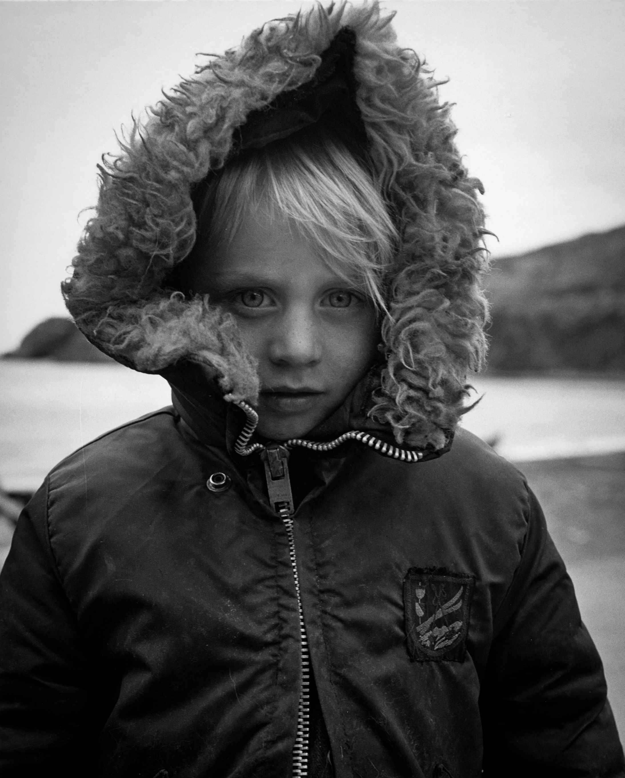 B&W portrait of a young child in Trout River, Newfoundland