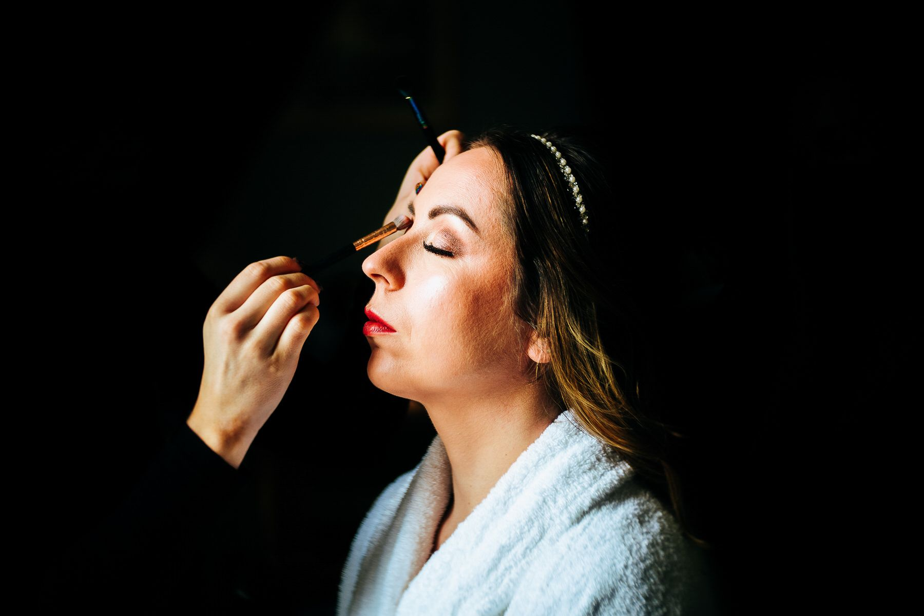 Bride getting make up done at Askham Hall