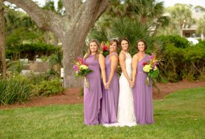 bridal party holding florals on lawn at Jekyll island beachview club hotel
