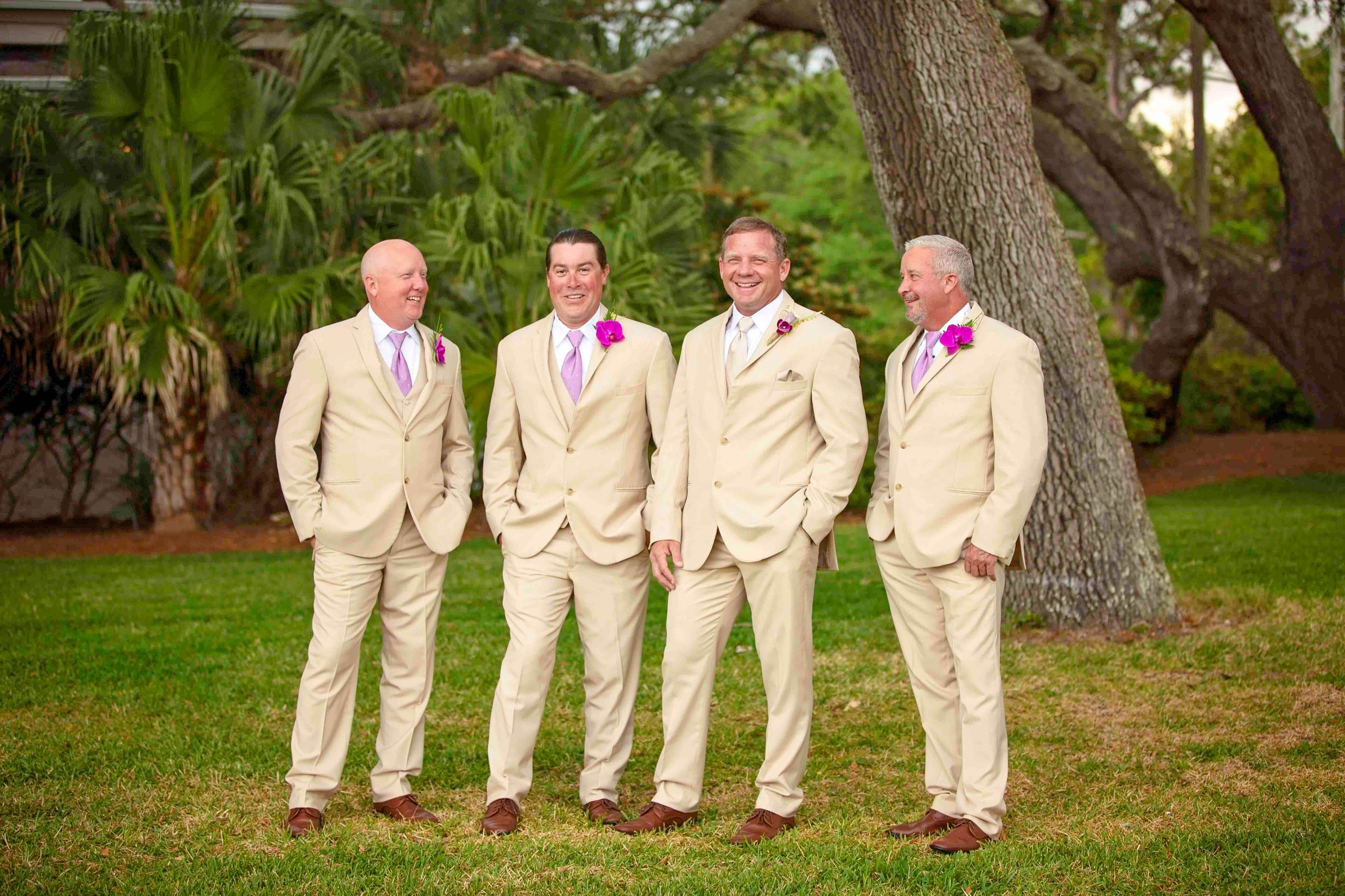 groomsmen standing on lawn at Jekyll island beachview club hotel