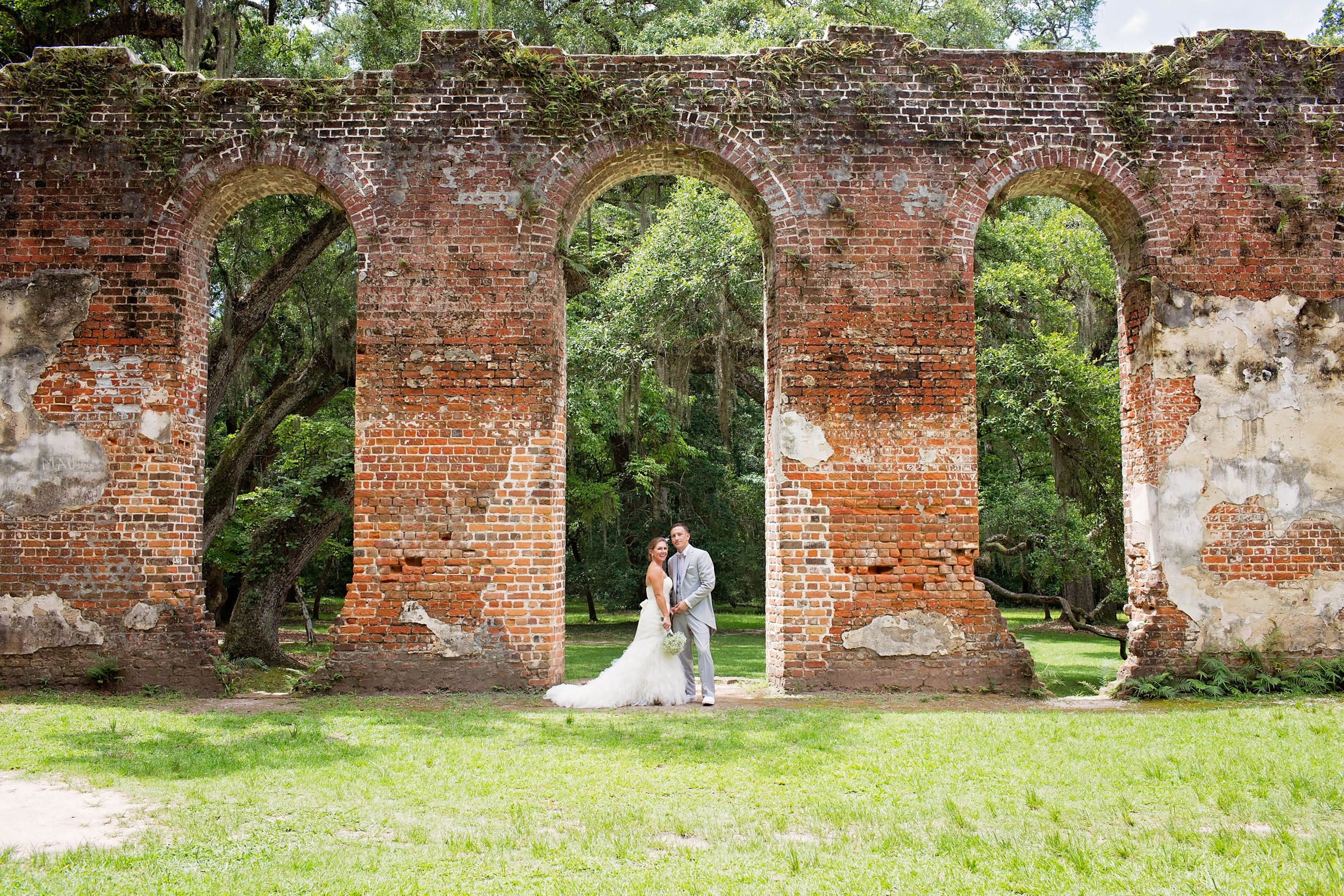 bride and groom standing at old church ruins in Beaufort, SC