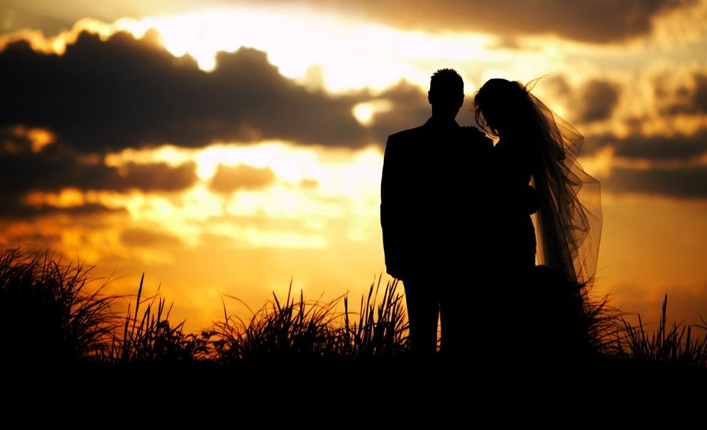 Sunset silhouette wedding photo at Castle Hill in Newport Rhode Island