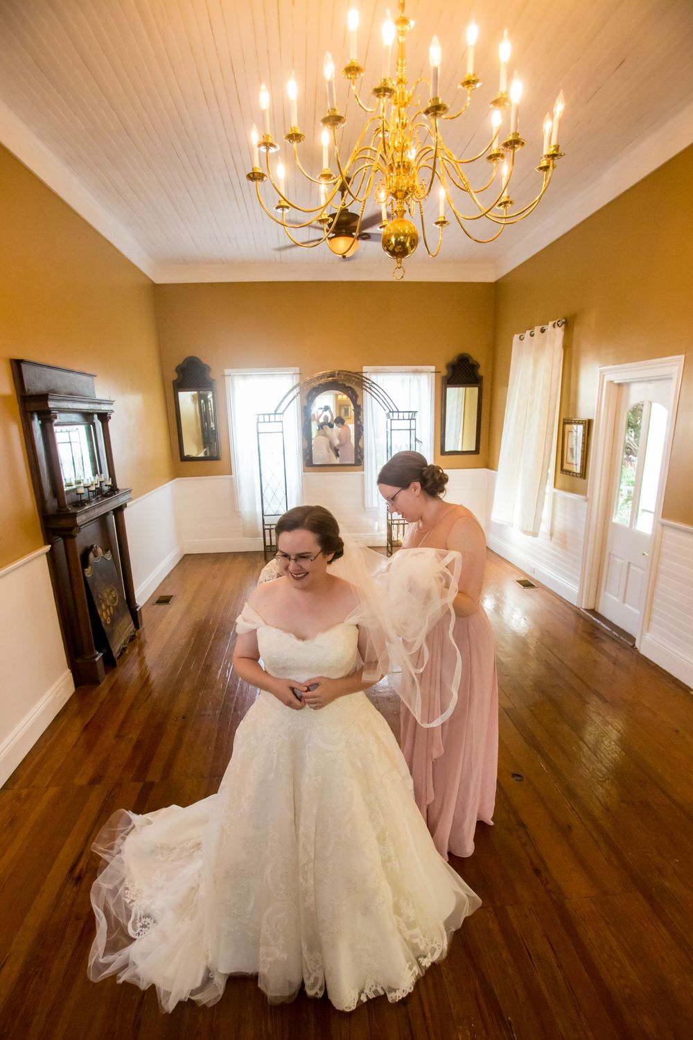 Bride Debra gets ready before her wedding at the River Road and Jasmine House in Lexington, SC
