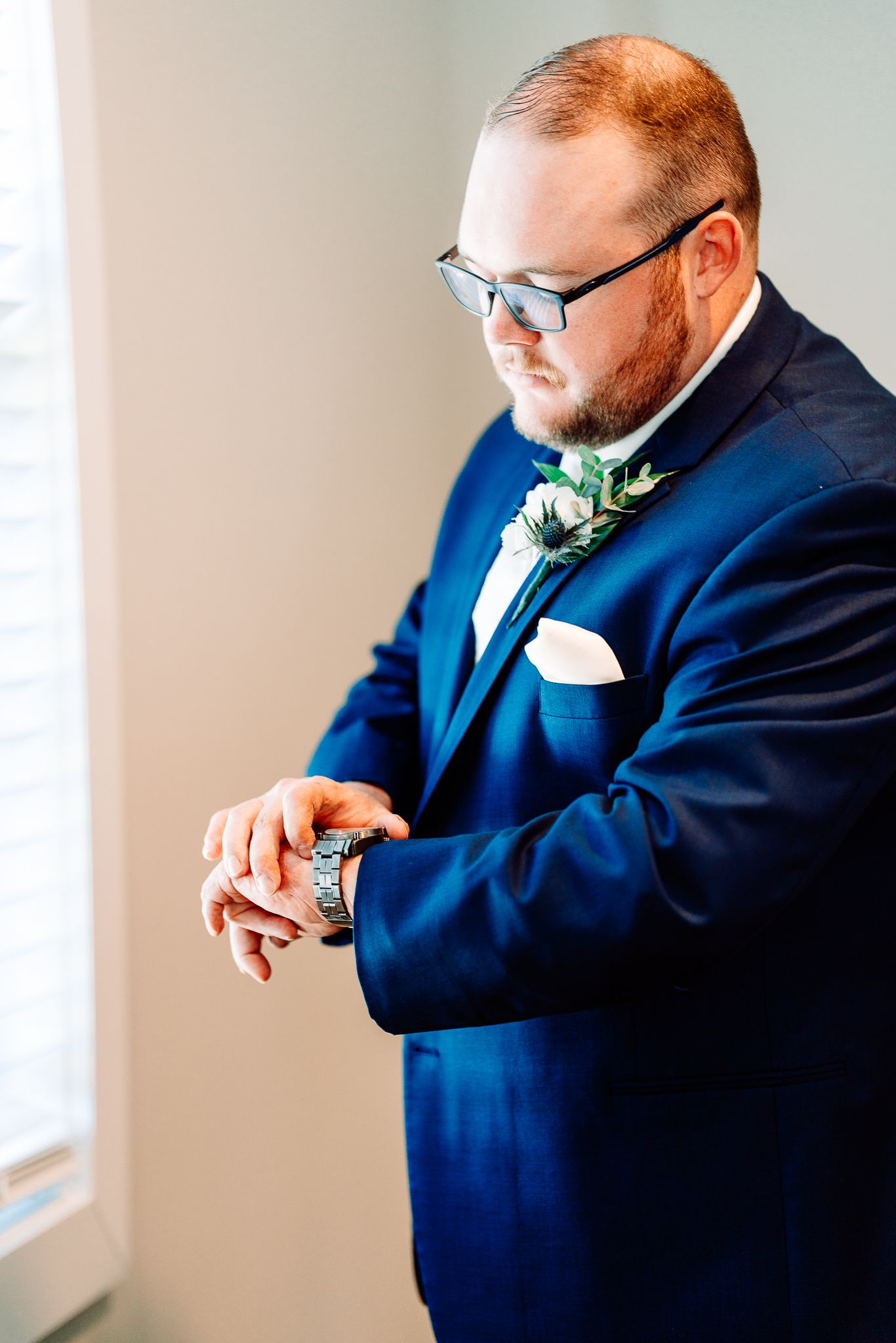groom looking at his watch at The Blessed Barn in Aynor, SC, by PHV Photo