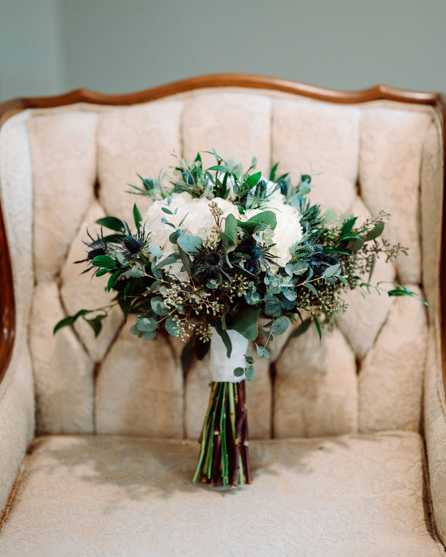 Bride bouquet on chair at The Blessed Barn in Aynor, SC, by PHV Photo