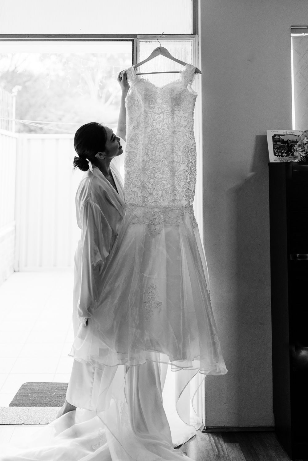 bride admiring her wedding dress