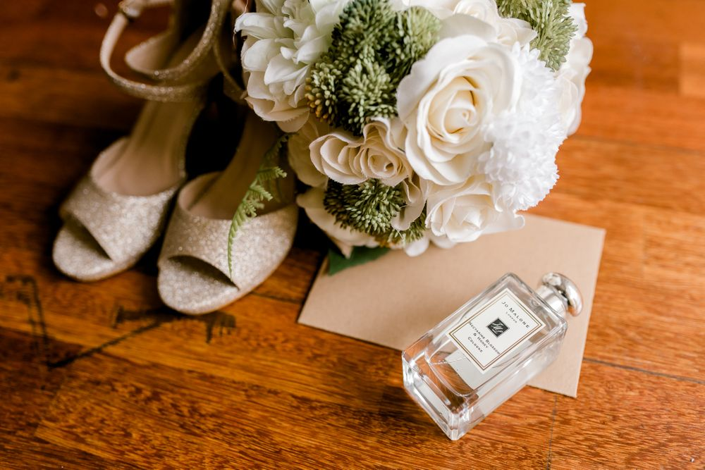 wedding shoes and flower bouquet on the floor