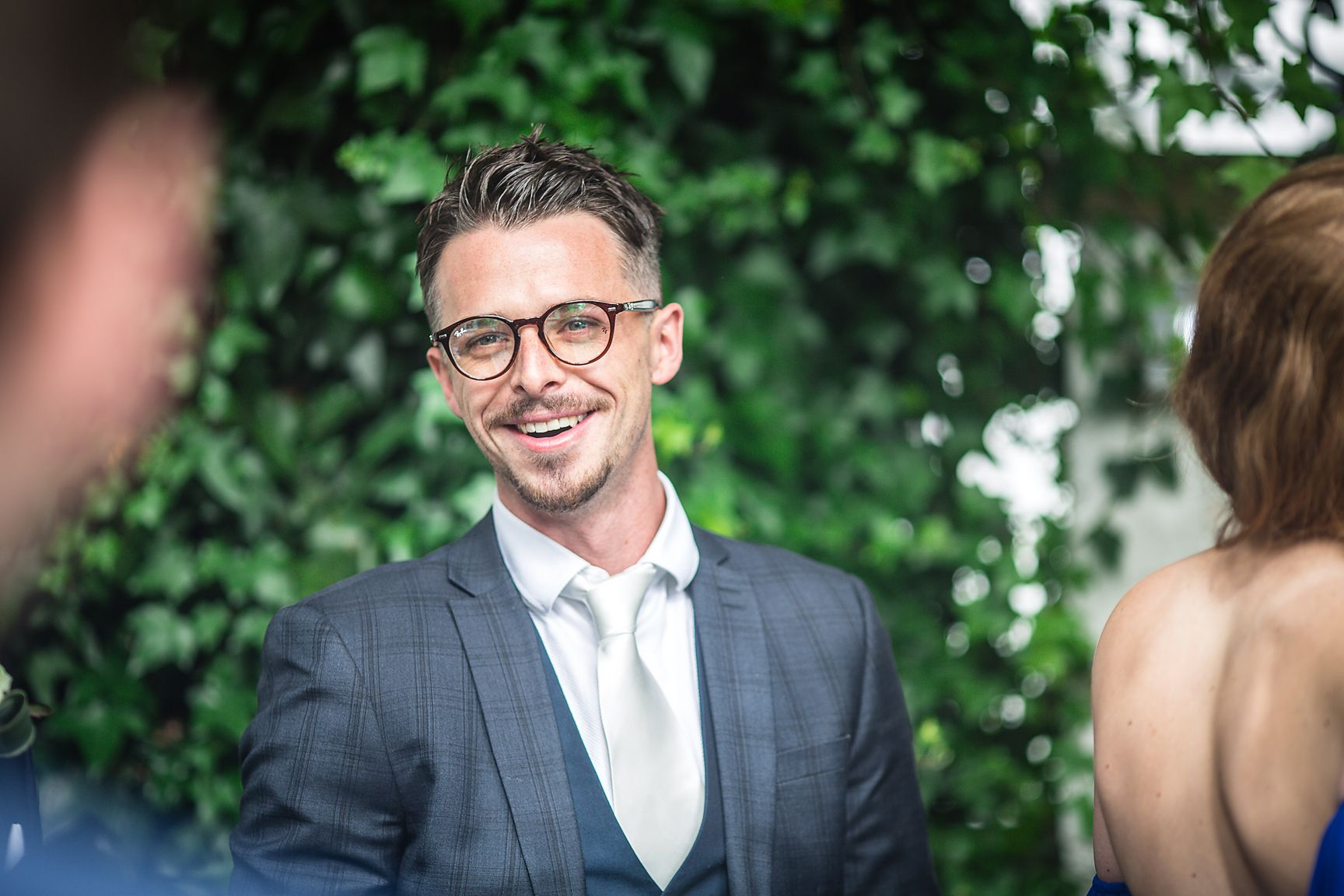 Cheshire wedding photographer photo of smiling male guest outdoors