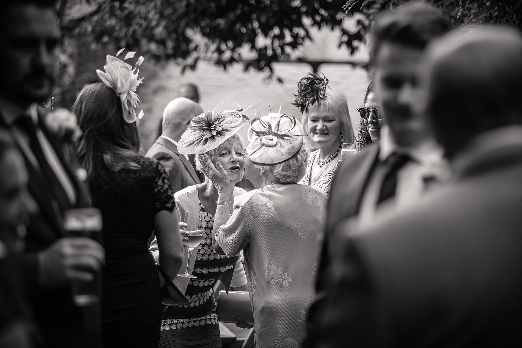 Cheshire wedding photographer shot of guests at a Peover marquee wedding