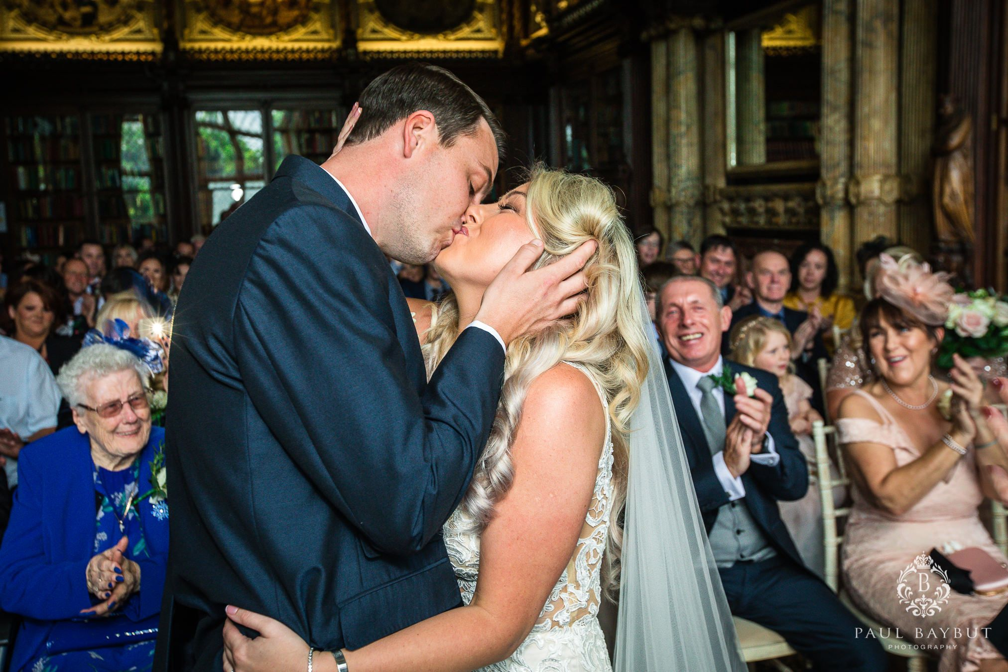 bride and groom kiss during the ceremony at Crewe Hall wedding venue