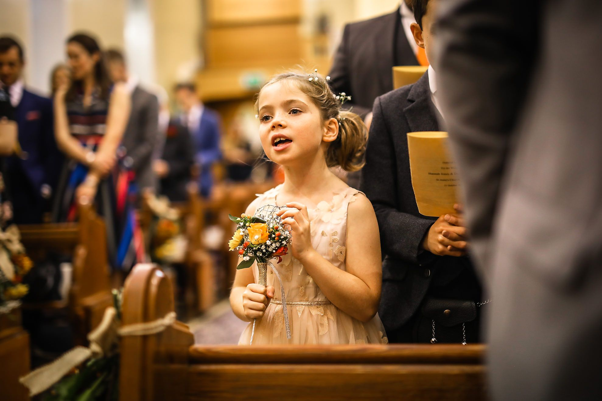 Hargate Hall wedding photography of little girl singing in church in Buxton