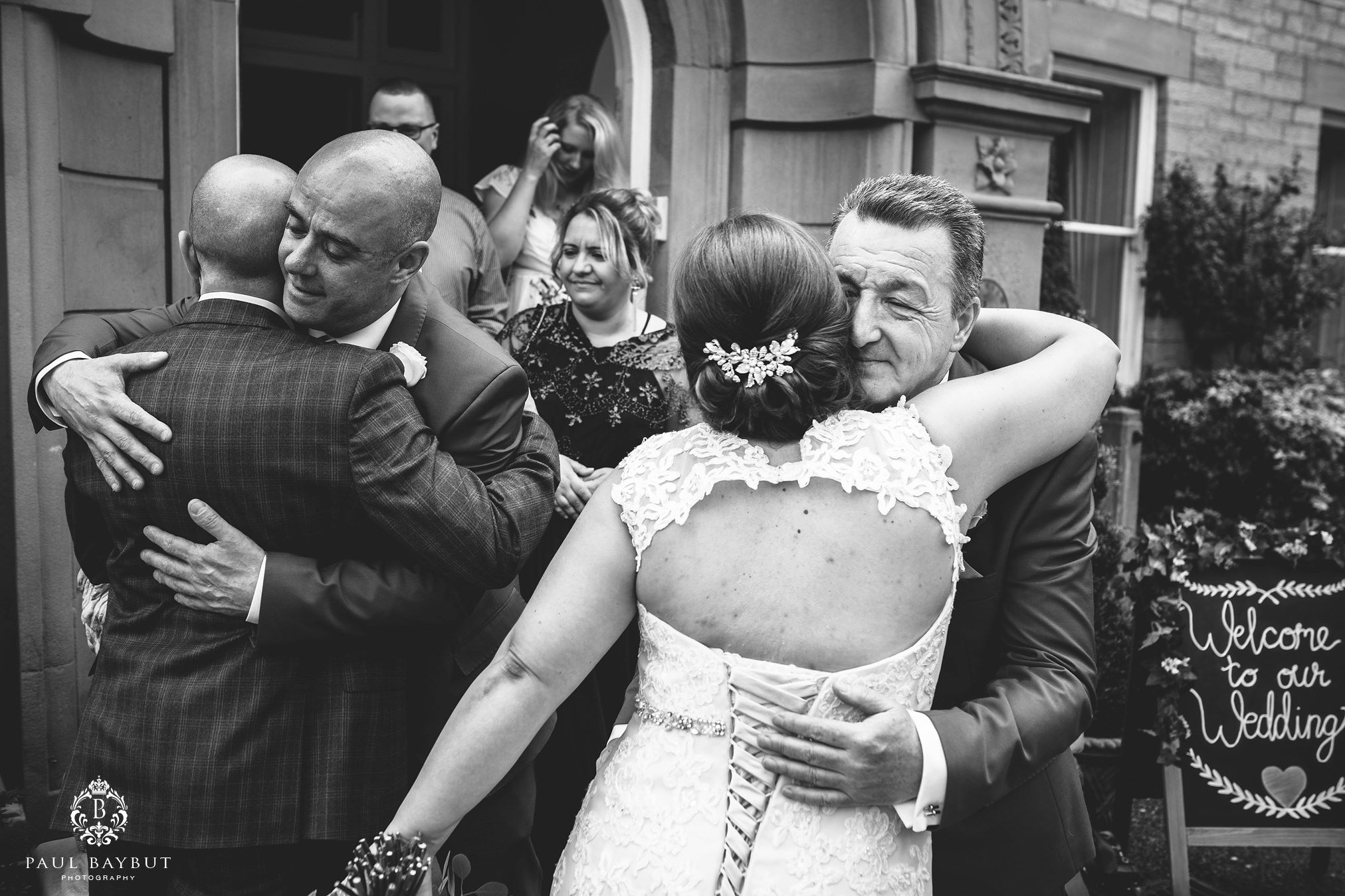 Father hugs the bride and is photographed by her Astely Bank Hotel wedding photographer