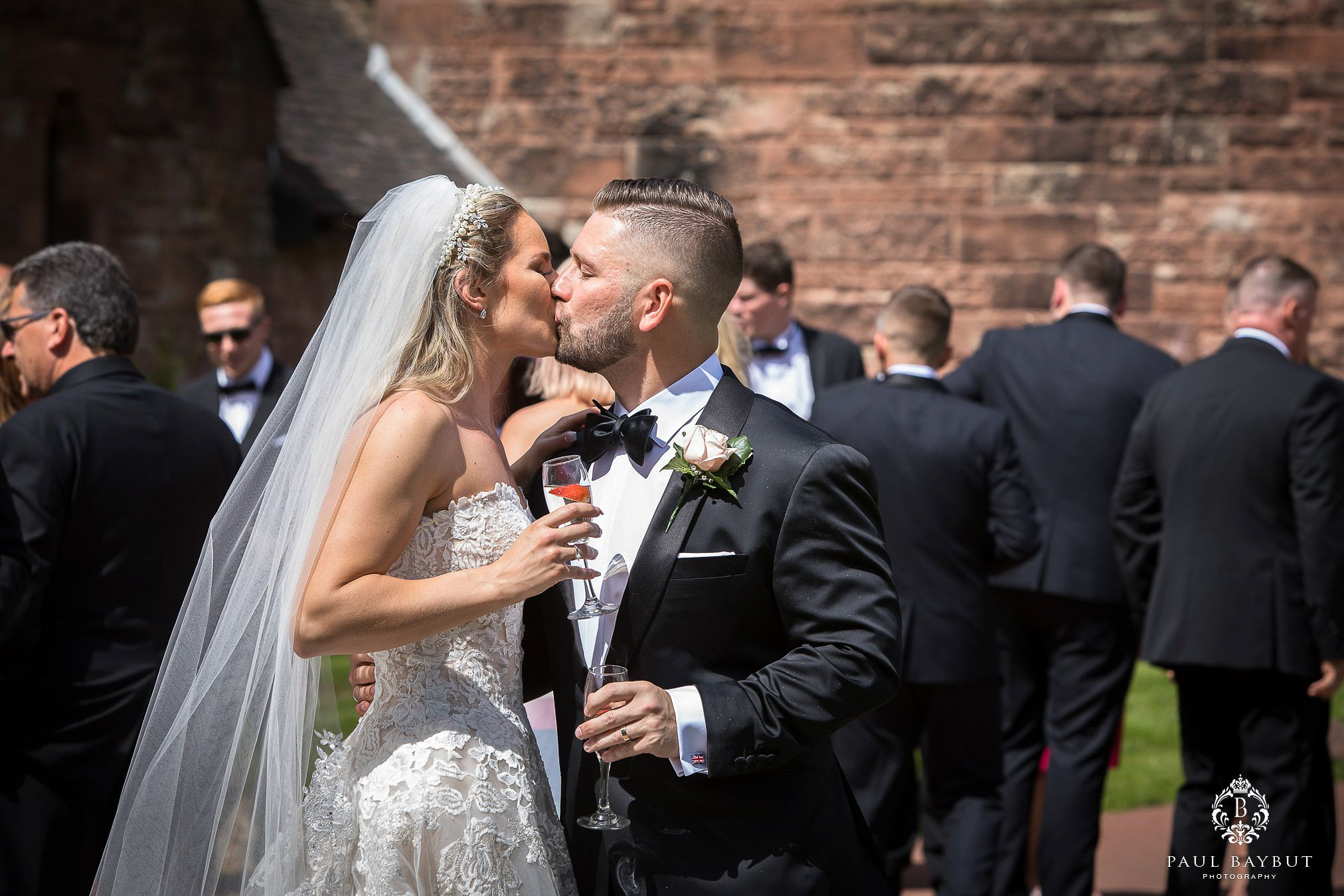 Bride and groom share a kiss at Peckforon castle during their first dance