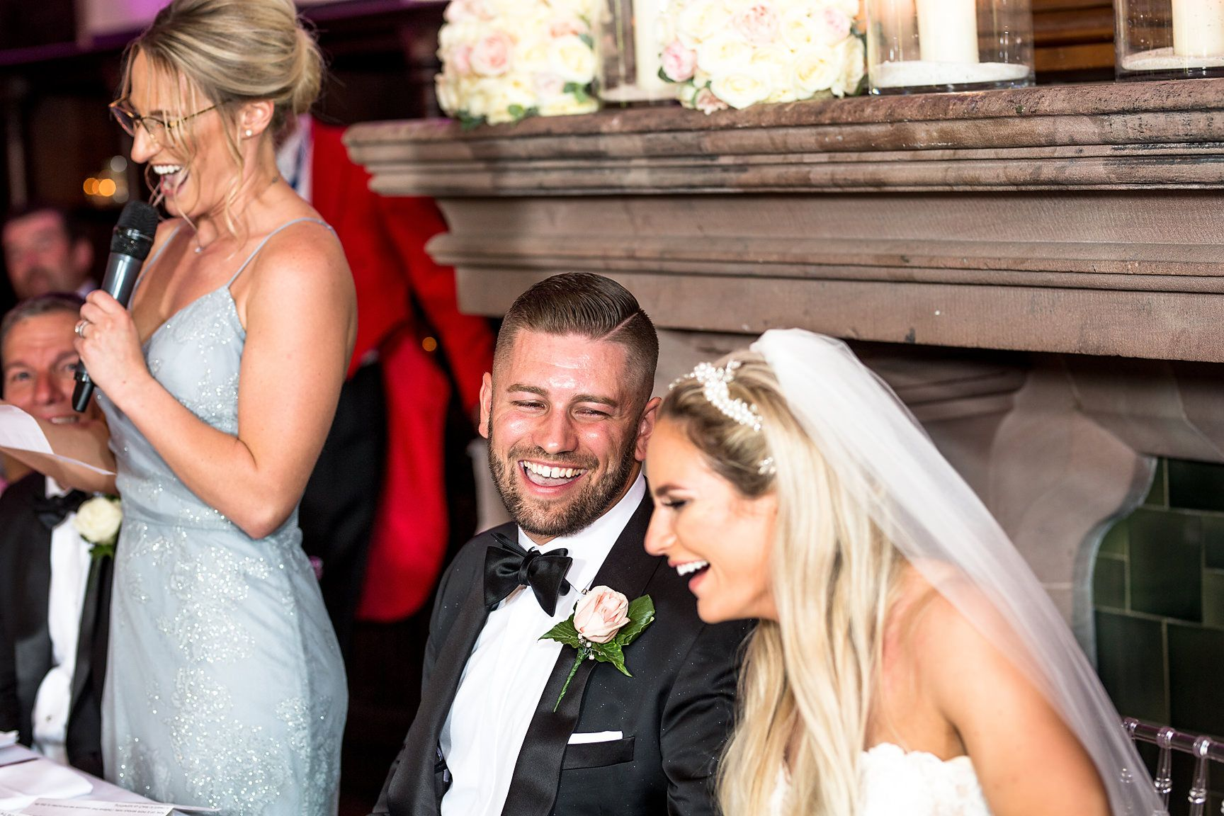 Peckforton castle wedding photography of groom smiling at bride during speeches
