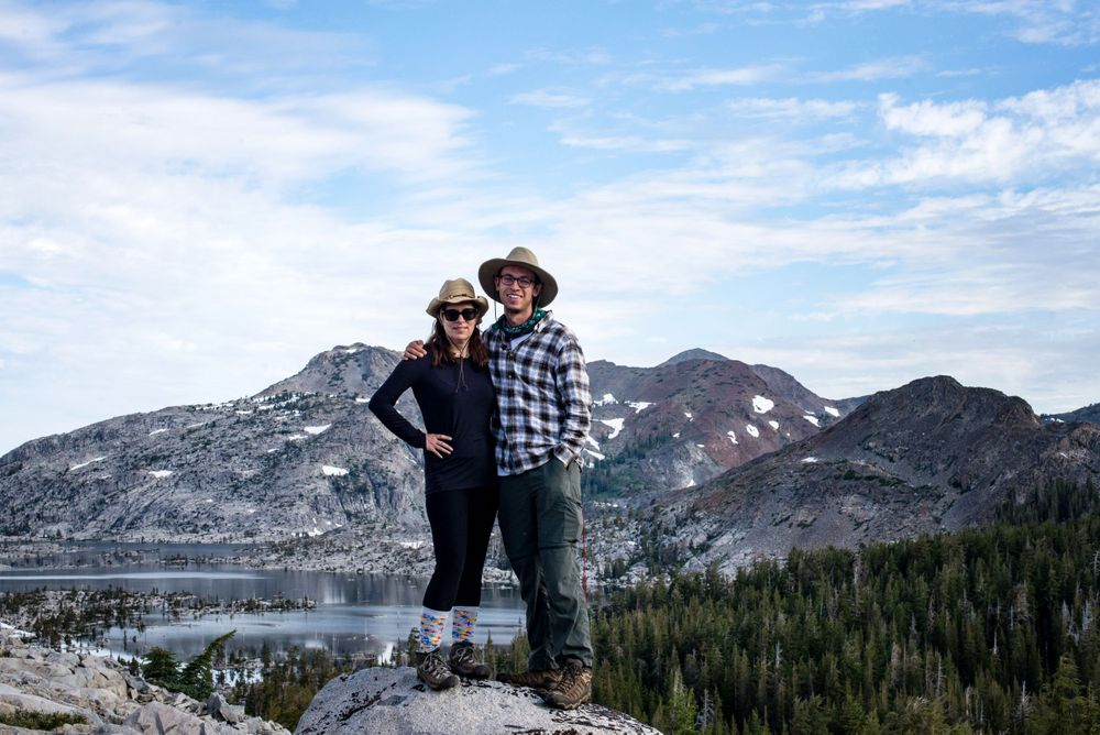 photographer heidi harting and son van harting on a peak in desolation wilderness overlooking aloha lake