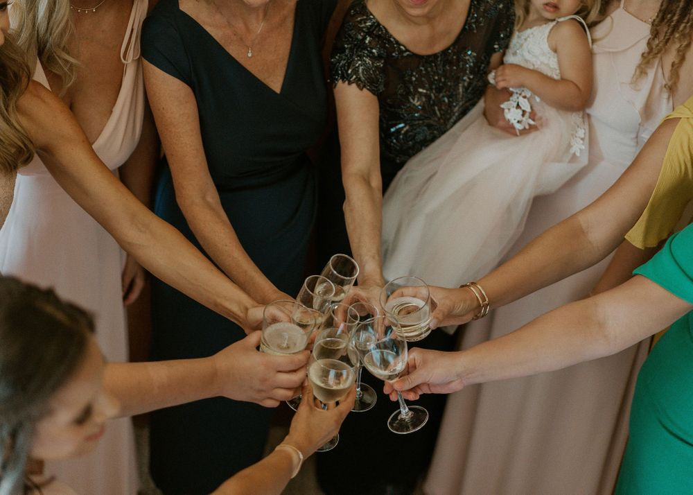 Bride's wedding party sharing a toast of champagne