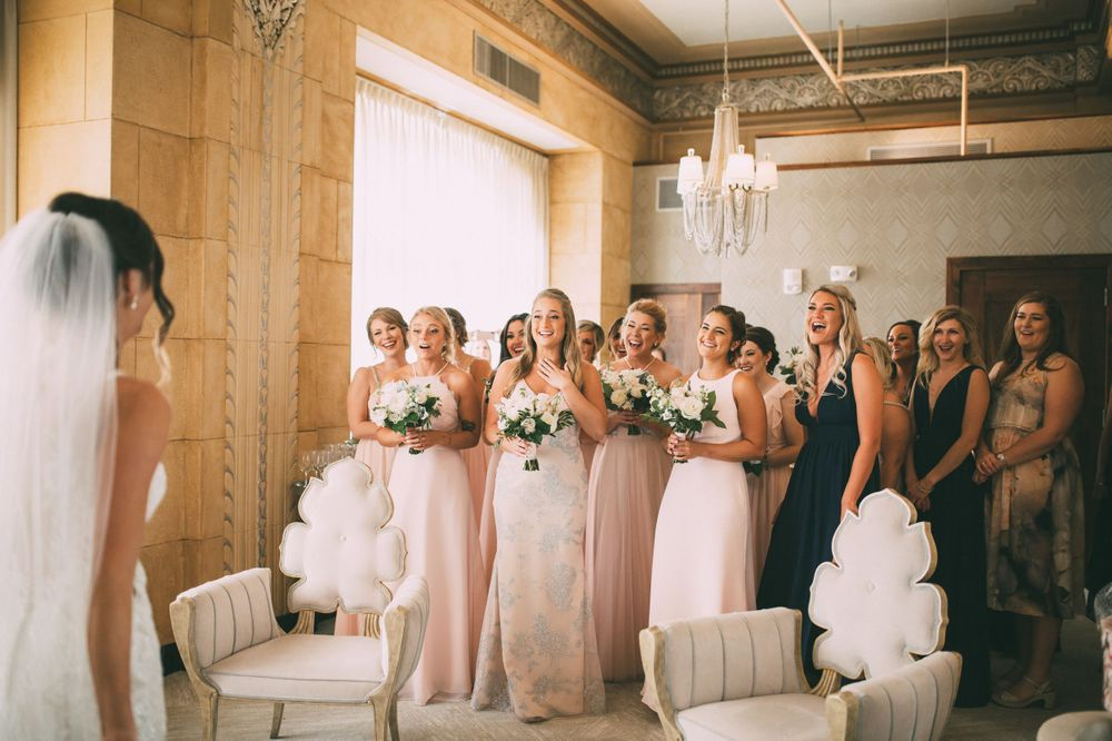 bridesmaids reveal and excitement seeing bride in her wedding dress