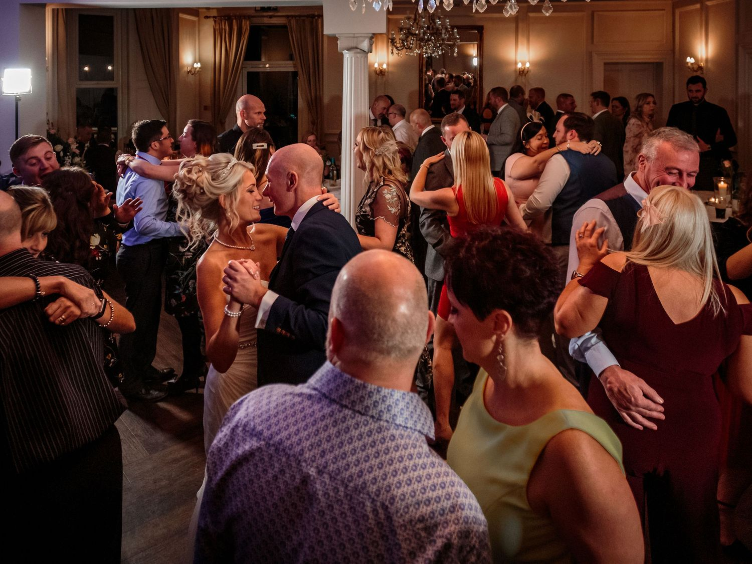 bride and groom dance surrounded by their guests on the ashfield house dancefloor