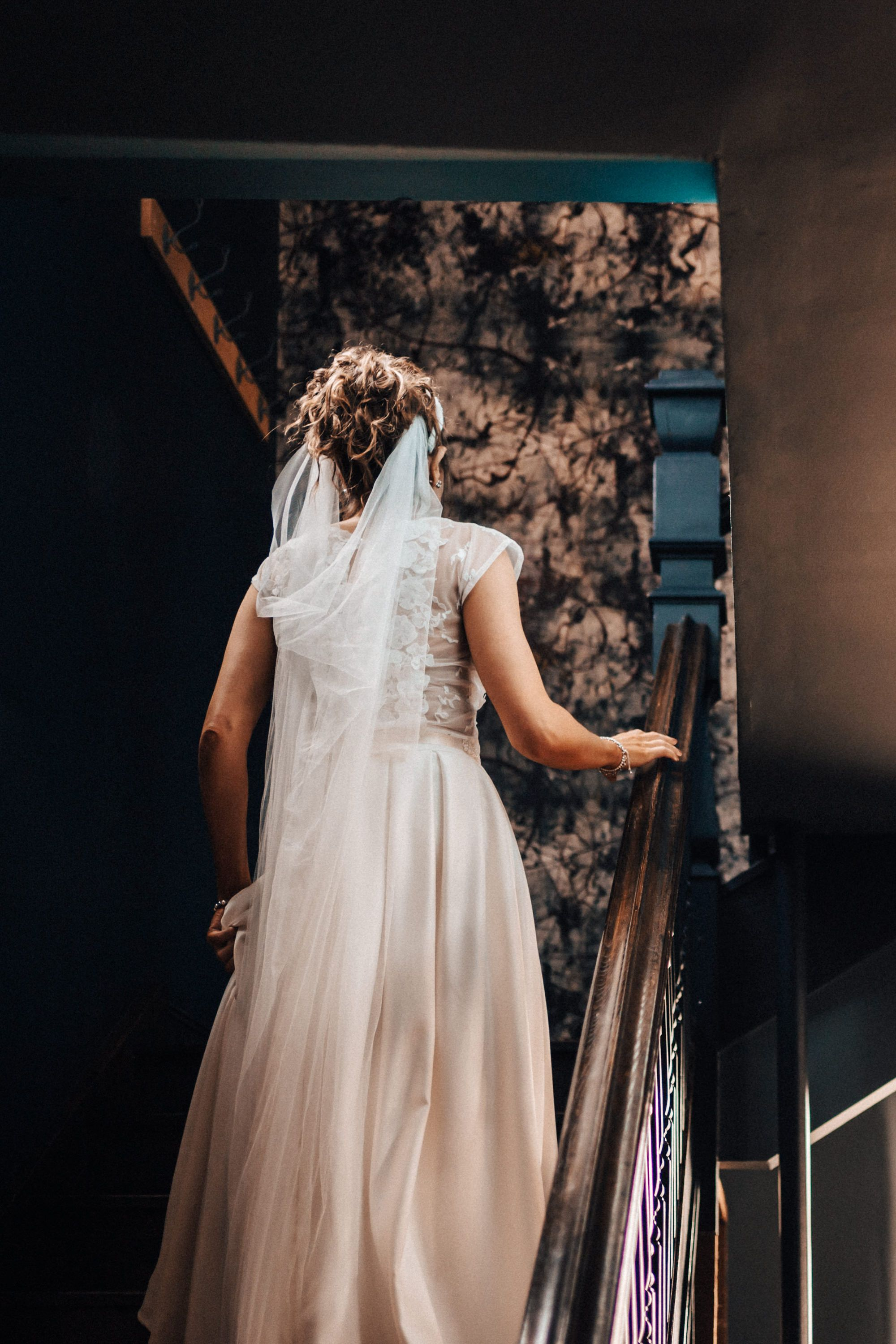 Beautiful photograph the bride's dress as she walked up the stairs taken at the Tavern cheltenham