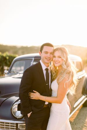 Married couple at sunset with Cass Winery vintage car
