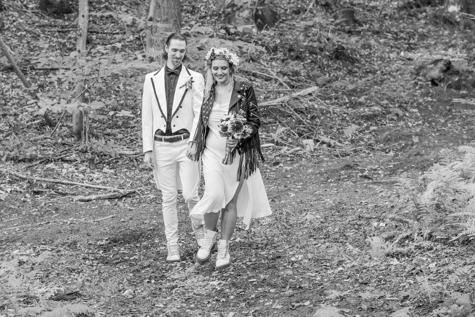 Bride and Groom walking on Vermont forest trail