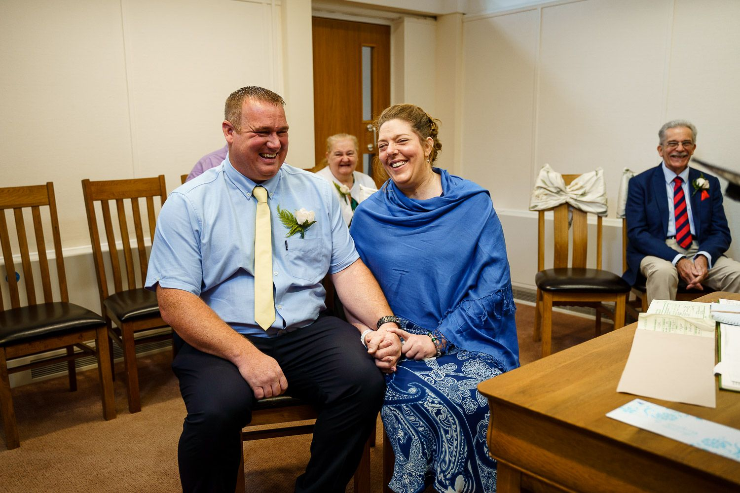 Bride and groom wearing blue at Southampton Registry Office wedding.
