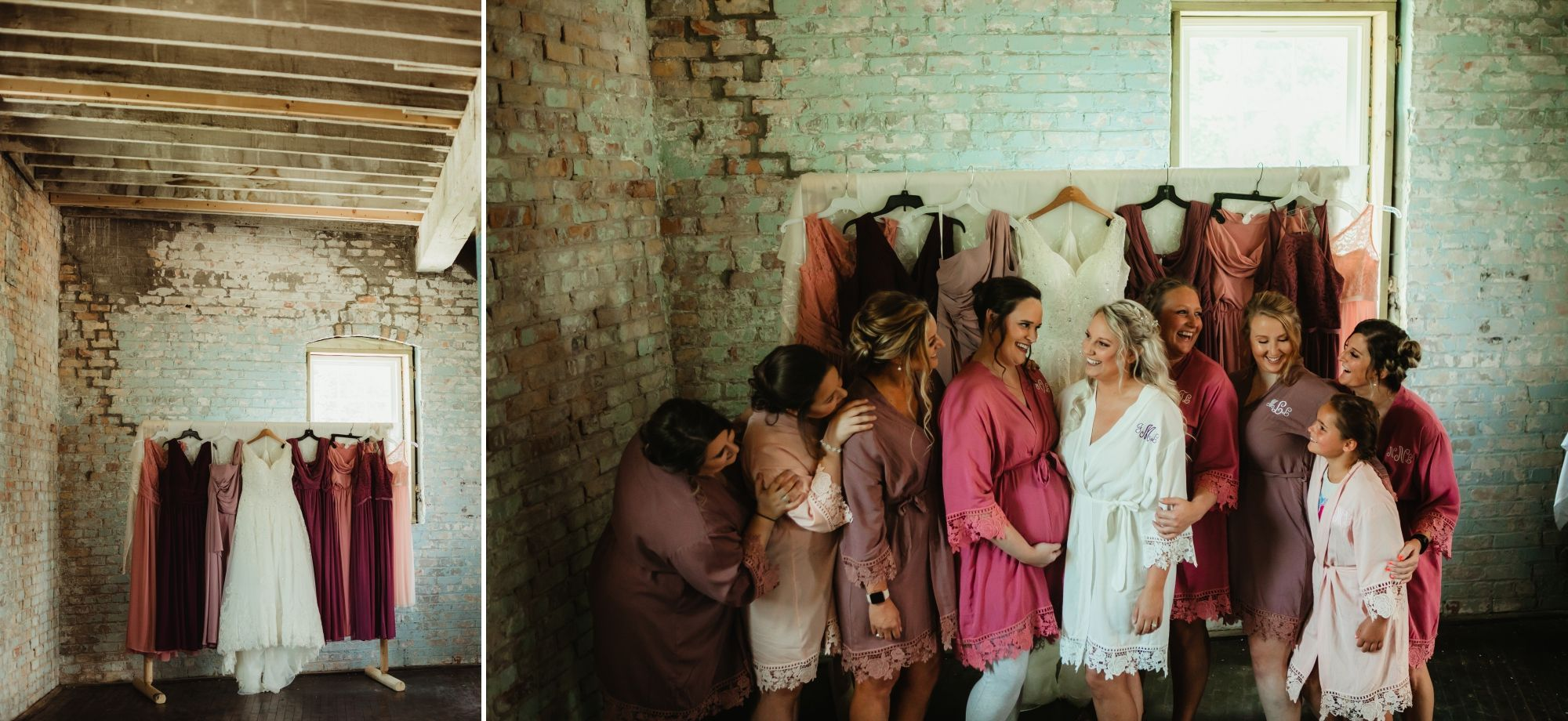 Bridesmaids smiling at each other and standing in front of the hanging dresses.