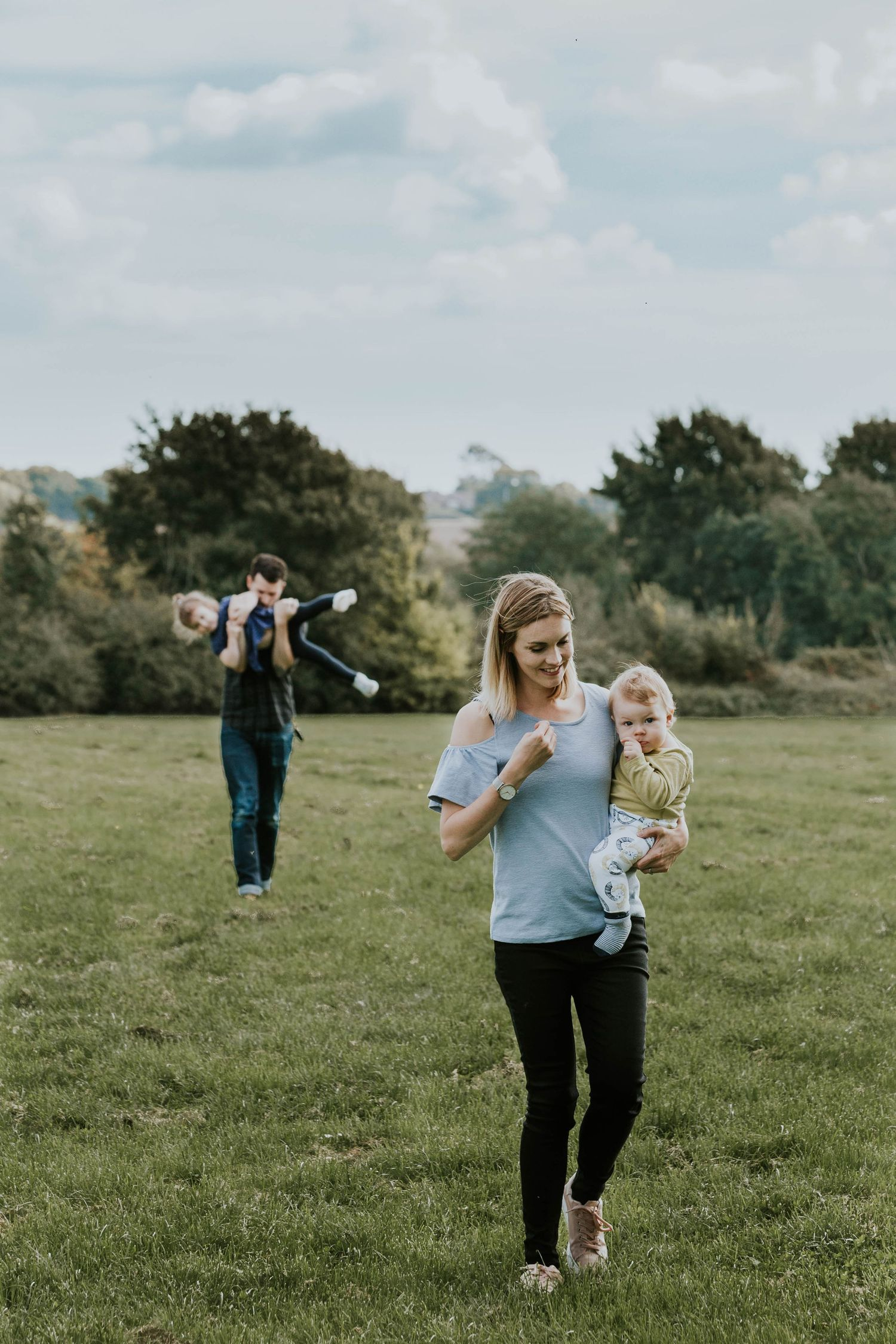 family of four in Hornchurch walking through field