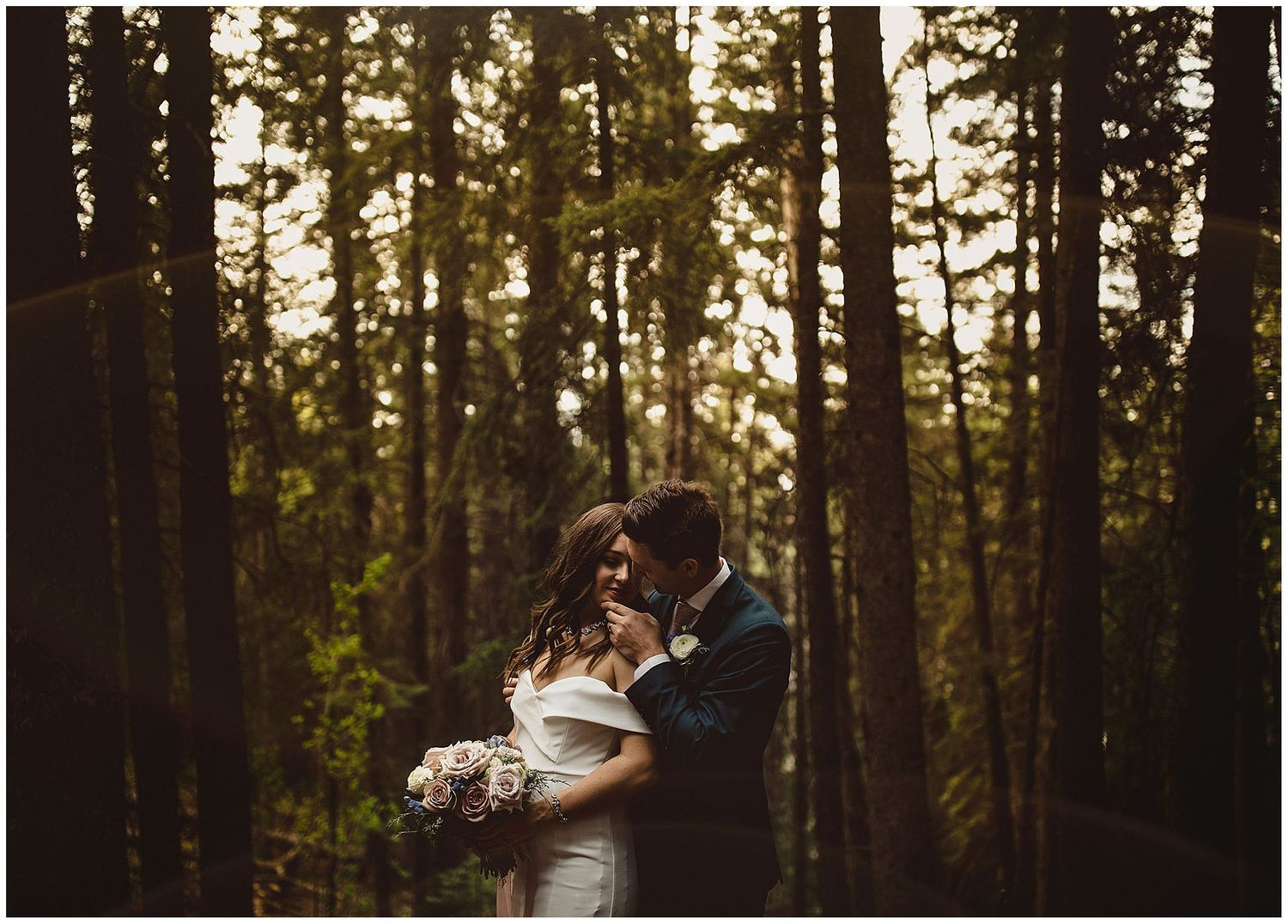 Calgary wedding photographer takes couple into trees