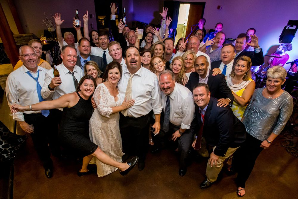 Bride Wendee & groom Bill pose with their guests during their wedding reception at Stone River in West Columbia, SC