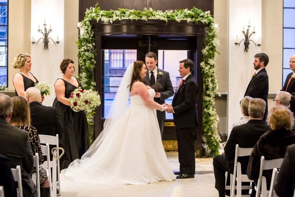 Bride Sarah and groom Charles exchange vows during their wedding ceremony at 1208 Washington Place in Columbia, SC