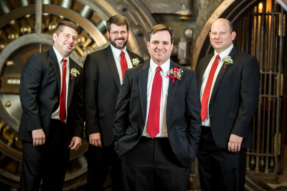 Groom Charles and his groomsmen pose in front of the bank vault at 1208 Washington Place in Columbia, SC