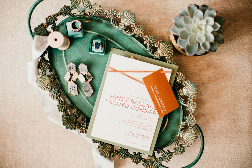 flatlay of wedding details and stationery