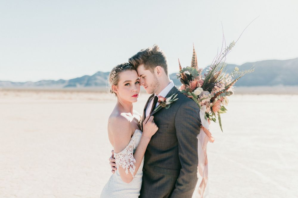 bride and groom standing on salt flats