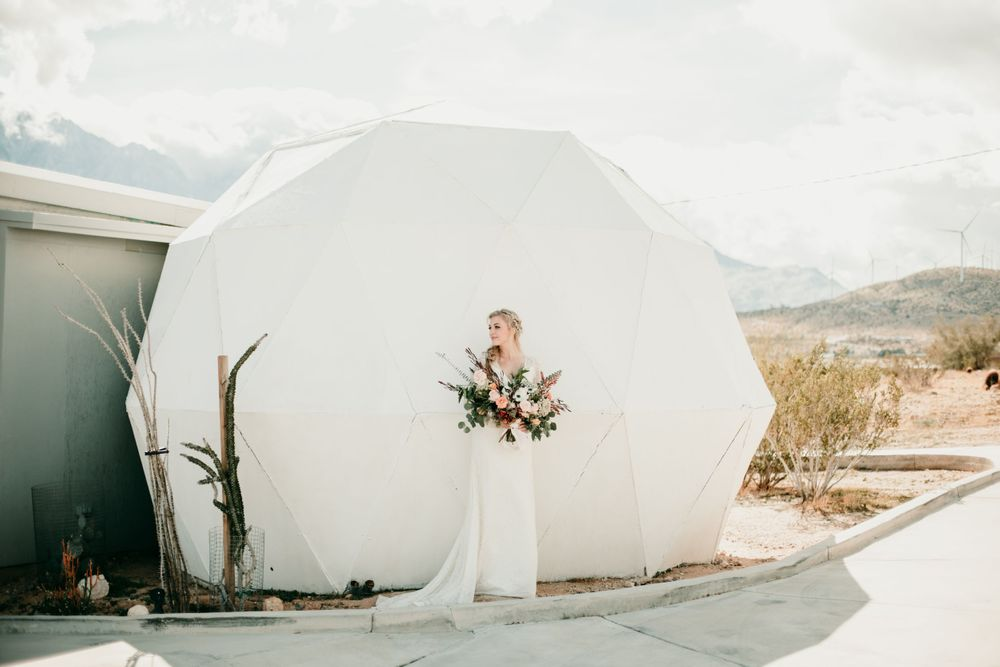 bride standing by tent on salt flats