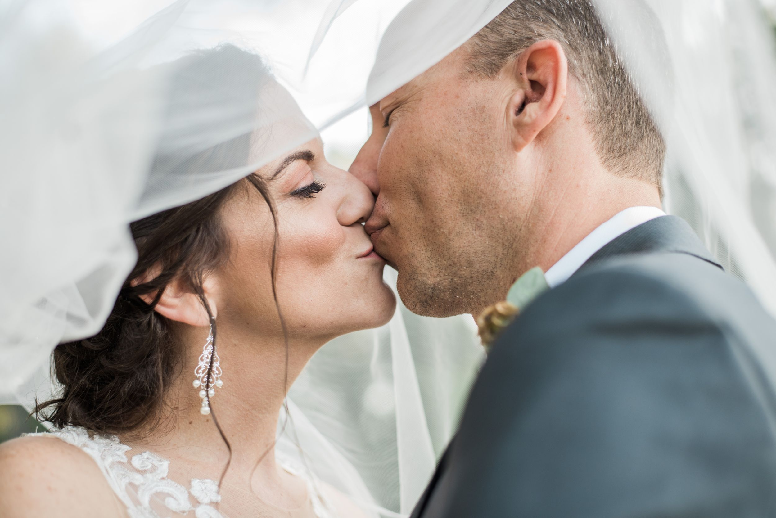 couple, couples photography, wedding, wedding photography, bride, groom, veil, kissing, kiss, kissing photo, smooch