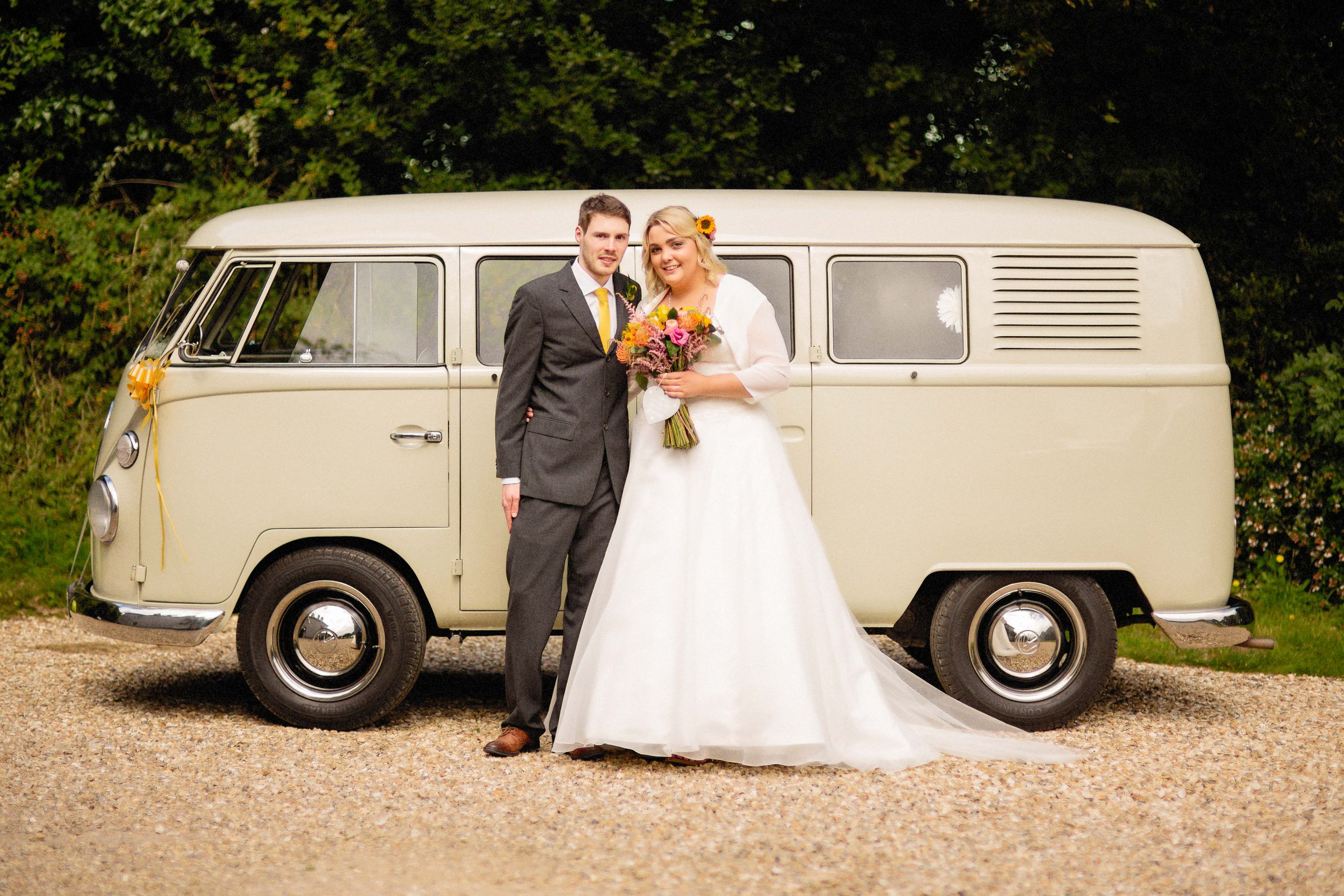 bride and groom wedding portrait by vw camper van