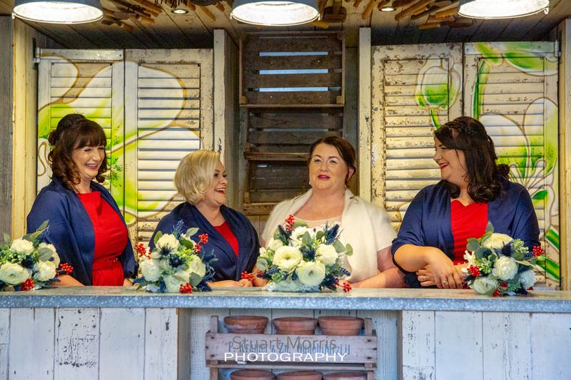 there bride and her bridesmaids behind the bar in the potted shed at oddfellows before the ceremony