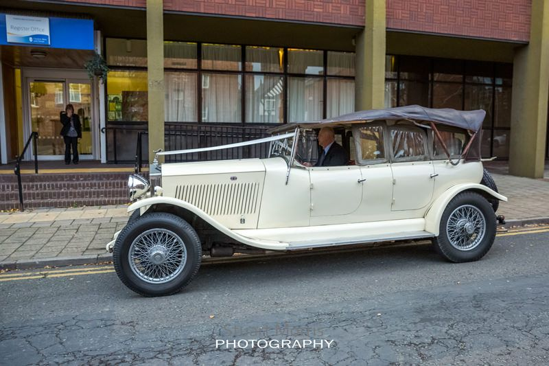 the brides vintage wedding car pulls up outside the registry office in chester