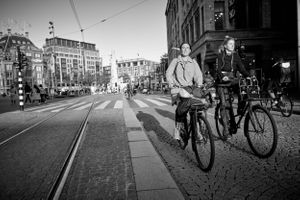 street photograph of 2 ladies on bicycles in Amsterdam.