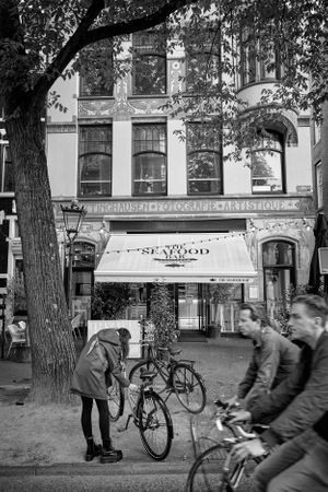 Amsterdam street photograph in black and white of a seafood restaurant.